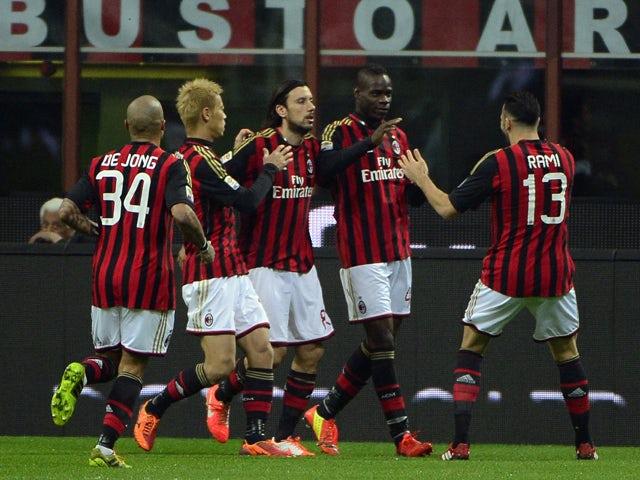 AC Milan's forward Mario Balotelli celebrates with teammates after scoring during the Italian Serie A football match AC Milan vs Chievo Verona, on March 29, 2014