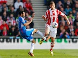 Ahmed Elmohamady of Hull City challenges Marko Arnautovic of Stoke City during the Barclays Premier League match on March 29, 2014