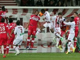 Ajaccio's French and Senegalese midfielder Ricardo Faty scores a header during the French L1 football match Ajaccio (ACA) vs Toulouse (TFC) on March 29, 2014