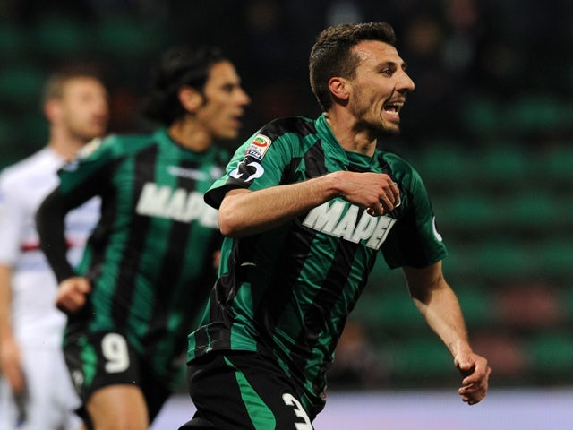 Alessandro Longhi of Sassuolo celebrates after scoring the goal 1-1 during the Serie A match between US Sassuolo Calcio and UC Sampdoria at Mapei Stadium on March 26, 2014
