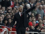 Arsenal's French Manager Arsene Wenger gestures from the touchline during the English Premier League football match between Arsenal and Manchester City at the Emirates Stadium in London on March 29, 2014
