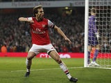 Arsenal's French midfielder Mathieu Flamini celebrates scoring a goal during the English Premier League football match between Arsenal and Manchester City at the Emirates Stadium in London on March 29, 2014