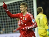 Bayern Munichs midfielder Toni Kroos celebrates scoring the 0-1 goal past Hertha's goalkeeper Thomas Kraft (R) the German first division Bundesliga football match Hertha BSC Berlin vs FC Bayern Munich in Berlin's Olympic Stadium on March 25, 2014