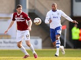 Ben Tozer of Northampton Town looks for the ball with Clive Platt of Bury during the Sky Bet League Two match on March 29, 2014