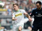 Monchengladbach's midfielder Patrick Herrmann and Hamburg's defender Heiko Westermann vie for the ball during the German first division Bundesliga football match Borussia Monchengladbach vs Hamburger SV in the German city of Monchengladbach on March 30, 2
