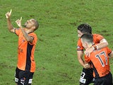 Henrique of the Roar celebrates after scoring a goal during the round 25 A-League match between Brisbane Roar and Melbourne Heart at Suncorp Stadium on March 28, 2014