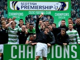 The Celtic squad celebrate winning the 2013-2014 Championship after the Scottish Premier League match between Celtic and Ross County at Celtic Park Stadium on March 29, 2014