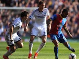 Jason Puncheon of Crystal Palace is closed down by Cesar Azpilicueta and Nemanja Matic of Chelsea during the Barclays Premier League match between Crystal Palace and Chelsea at Selhurst Park on March 29, 2014