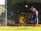 John Terry of Chelsea is pressured by Joe Ledley of Crystal Palace and heads the ball over his goalkeeper Petr Cech to open the scoring with an own goal during the Barclays Premier League match between Crystal Palace and Chelsea at Selhurst Park on March