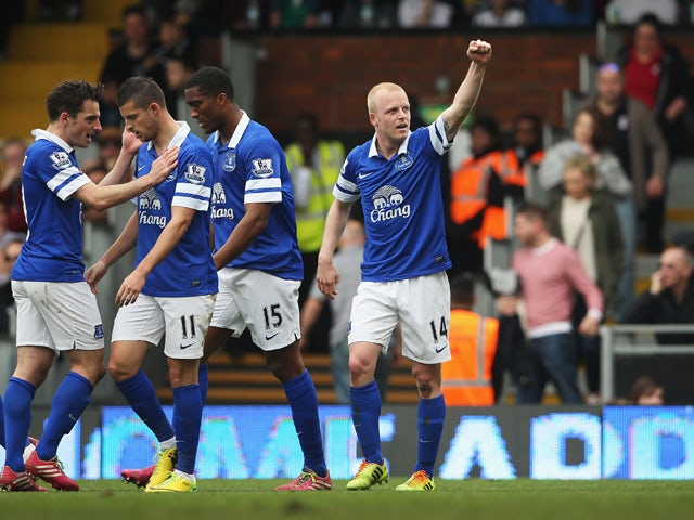 Steven Naismith of Everton celebrates scoring his team's third goal with team mates during the Barclays Premier League match between Fulham and Everton at Craven Cottage on March 30, 2014