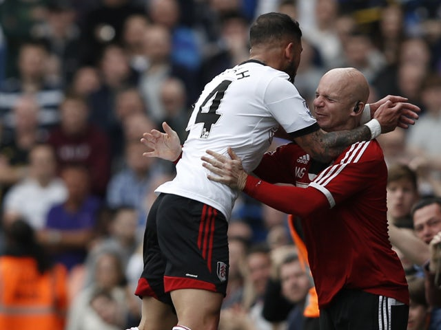 Fulham's Iranian midfielder Ashkan Dejagah celebrates after scoring his team's first goal to equalise during the English Premier League football match between Fulham and Everton at Craven Cottage in London on March 30, 2014