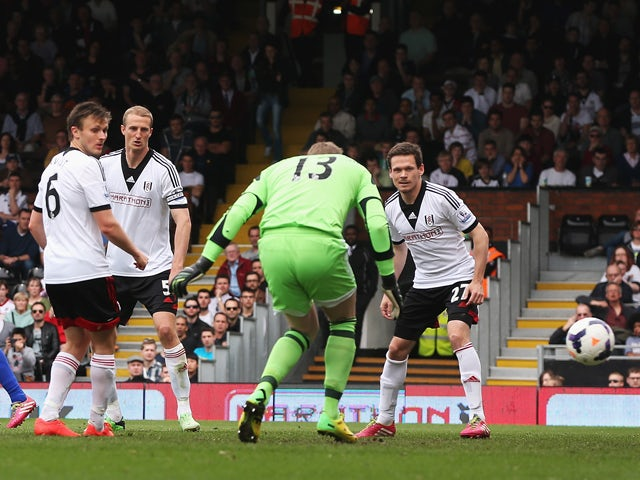 Goalkeeper David Stockdale of Fulham fails to stop a shot by Steven Naismith of Everton for the opening goal during the Barclays Premier League match between Fulham and Everton at Craven Cottage on March 30, 2014