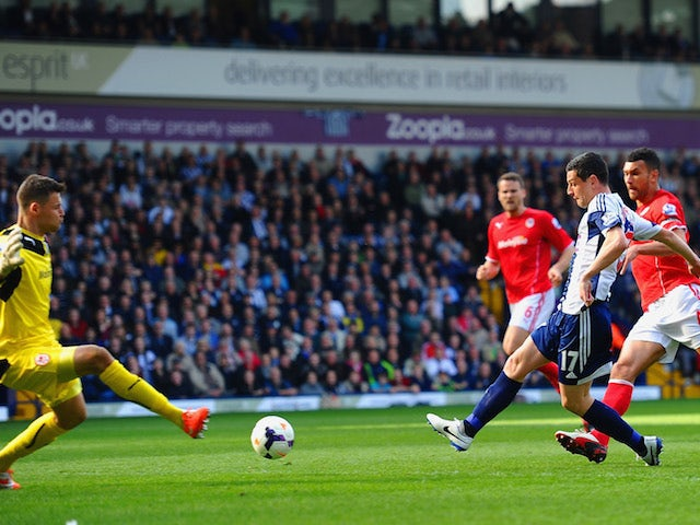 Graham Dorrans of West Brom scores the second goal past David Marshall of Cardiff City during the Barclays Premier League match on March 29, 2014