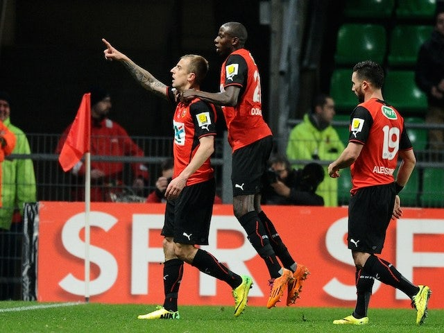 Rennes' Polish forward Kamil Grosicki (C) celebrates with teammates after scoring a goal during the French Cup quarter final football match between Rennes and Lille on March 27, 2014