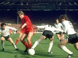 Kenny Dalglish battles for possession with Manchester United players on March 26, 1983.