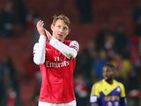 Kim Kallstrom of Arsenal looks on during the Barclays Premier League match between Arsenal and Swansea City at Emirates Stadium on March 25, 2014