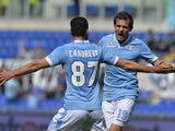 Lazio's defender Senad Lulic of Bosnia and Herzegovina celebrates with teammate Lazio's midfielder Antonio Candreva during the Italian Serie A football match on March 30, 2014