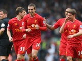 Jordan Henderson of Liverpool celebrates with his team-mates after scoring the fourth goal during the Barclays Premier League match between Liverpool and Tottenham Hotspur at Anfield on March 30, 2014