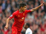 Philippe Coutinho of Liverpool celebrates scoring the third goal during the Barclays Premier League match between Liverpool and Tottenham Hotspur at Anfield on March 30, 2014