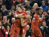Liverpool's English midfielder Steven Gerrard celebrates scoring the opening goal from a freekick with Liverpool's Uruguayan striker Luis Suarez during the English Premier League football match between Liverpool and Sunderland at Anfield in Liverpool, nor