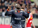 Lorient's Cameroonian forward Vincent Aboubakar celebrates after scoring a goal during the French Ligue 1 football match between Stade de Reims and FC Lorient, on March 29, 2014