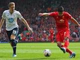 Liverpool's Luis Suarez scores against Tottenham Hotspur on March 30, 2014.