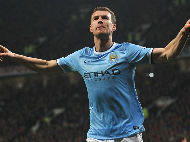 Manchester City's Bosnian forward Edin Dzeko celebrates after scoring the second goal during the English Premier League football match between Manchester United and Manchester City at Old Trafford in Manchester on March 25, 2014