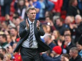 Manchester United Manager David Moyes applauds the fans at the end of the Barclays Premier League match between Manchester United and Aston Villa at Old Trafford on March 29, 2014