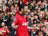 Juan Mata of Manchester United celebrates scoring his team's third goal during the Barclays Premier League match between Manchester United and Aston Villa at Old Trafford on March 29, 2014