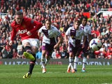 Wayne Rooney of Manchester United scores his team's second goal from a penalty kick during the Barclays Premier League match between Manchester United and Aston Villa at Old Trafford on March 29, 2014