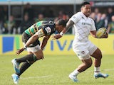 Manu Tuilagi of Leicester breaks away from Northampton's Luther Burrell during the Aviva Premiership match on March 29, 2014