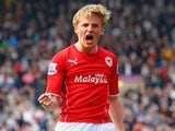 Mats Moller Daehli of Cardiff City celebrates scoring their third goal during the Barclays Premier League match between West Brom on March 29, 2014