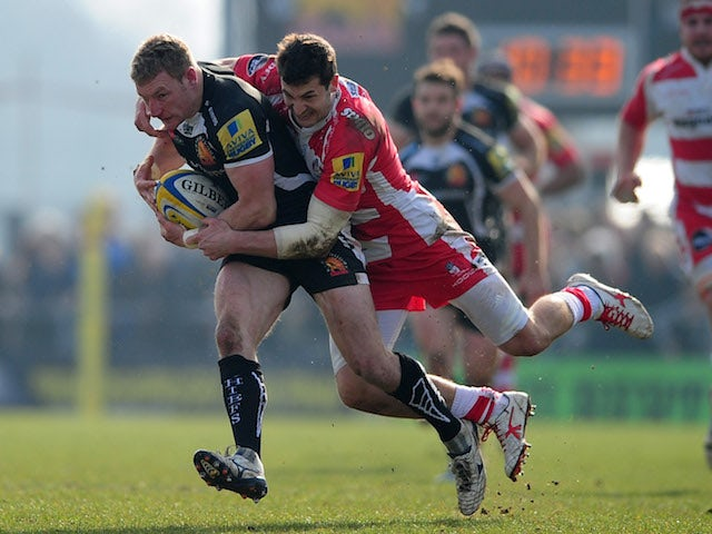 Matt Jess of Exeter Chiefs is tackled by Jonny May of Gloucester during the Aviva Premiership match between Exeter Chiefs and Gloucester at Sandy Park on March 29, 2014