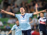 Richard Garcia of Sydney celebrates after Joel Chianese of Sydney scored a goal during the round 25 A-League match between Melbourne Victory and Sydney FC at AAMI Park on March 29, 2014