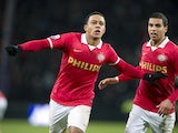 PSV Eindhoven player Memphis Depay celebrates scoring an equalizing goal with teammate Adam Maher during the Dutch Eredivisie soccer match between PSV Eindhoven and Vitesse Arnhem in Eindhoven, The Netherlands, on December 7, 2013