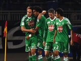St Etienne's Mevlut Erding, Brandao, Fabien Lemoine and Benoit Tremoulinas celebrate after Erding opened the scoring during the French L1 football match between Olympique Lyonnais (OL) vs Saint-Etienne (ASSE) at the Gerland stadium in Lyon, central easter