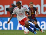 Hamburg's British defender Michael Mancienne controls the ball during a pre-season friendly football match between Hamburger SV and FC Barcelona in Hamburg, northern Germany, on July 24, 2012