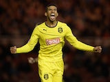 Oscar Gobern of Huddersfield celebrates during the Sky Bet Championship match between Middlesbrough and Huddersfield Town at Riverside Stadium on October 01, 2013
