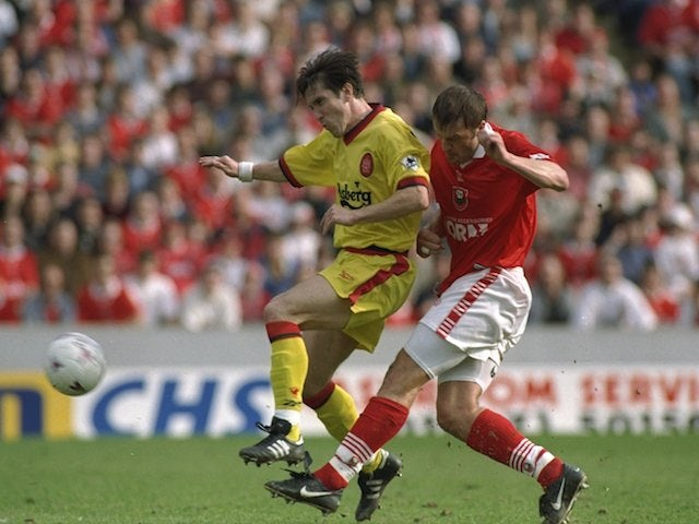 Neil Redfearn of Barnsley challenges Oyvind Leonhardsen of Liverpool during the FA Carling Premiership match at Oakwell on March 28, 1998