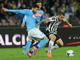 Raul Albiol of Napoli and Pablo Osvaldo of Juventus in action during the Serie A match between SSC Napoli and Juventus at Stadio San Paolo on March 30, 2014