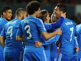 Real Madrid's Portuguese forward Cristiano Ronaldo celebrates with his teammates after scoring during the Spanish league football match Sevilla FC vs Real Madrid CF at the Ramon Sanchez Pizjuan stadium in Sevilla on March 26, 2014