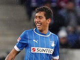 Hoffenheim's Brazilian midfielder Roberto Firmino celebrates after striker Kevin Volland's goal during the German first division Bundesliga football match 1899 Hoffenheim vs FC Schalke 04 on November 3, 2012