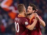 AS Roma's forward Mattia Destro is congratulated by his teammate AS Roma's forward Francesco Totti, after he scored a goal during the Italian Serie A football match between As Roma and Torino on March 25, 2014