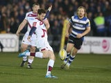 Danny Cipriani of Sale kicks the ball upfield during the Aviva Premiership match between Bath and Sale Sharks at the Recreation Ground on March 28, 2014