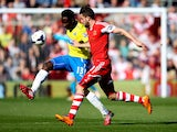 Mapou Yanga-Mbiwa of Newcastle passes ahead of Jay Rodriguez of Southampton during the Barclays Premier League match between Southampton and Newcastle United at St Mary's Stadium on March 29, 2014
