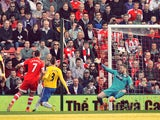 Southampton's English striker Rickie Lambert scores their second goal past Newcastle United's English goalkeeper Rob Elliot (R) during the English Premier League football match between Southampton and Newcastle United at St Mary's Stadium in Southampton,