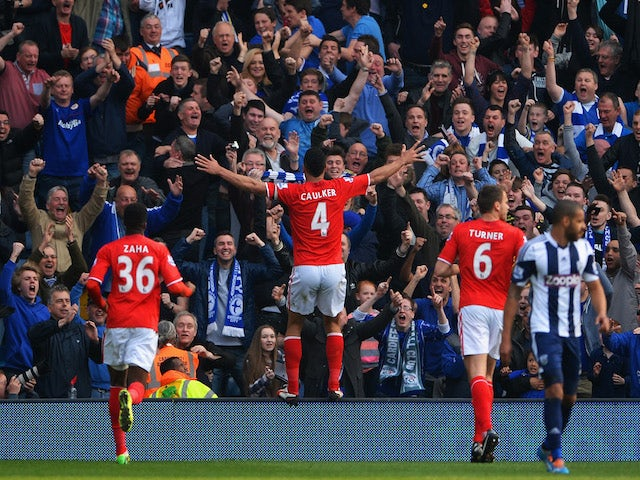 Steven Caulker of Cardiff City celebrates infront of the Cardiff City fans after scoring their second goal during the Barclays Premier League match on March 29, 2014
