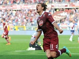 Alessio Cerci of Torino FC celebrates scoring their second goal during the Serie A match between Torino FC and Cagliari Calcio at Stadio Olimpico di Torino on March 30, 2014