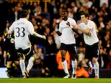 Louis Saha of Spurs is congratulated by teammates Ryan Nelsen and Gareth Bale after scoring his team's third goal during the FA Cup sixth round match between Tottenham Hotspur and Bolton Wanderers at White Hart Lane on March 27, 2012