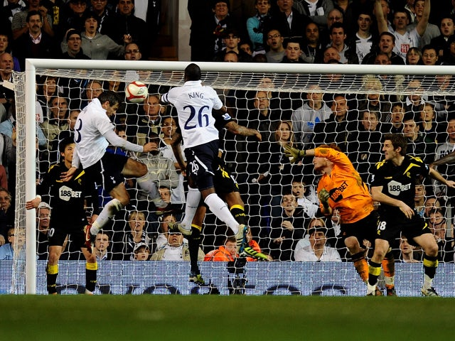 Ryan Nelsen of Spurs scores the opening goal with a header during the FA Cup sixth round match between Tottenham Hotspur and Bolton Wanderers at White Hart Lane on March 27, 2012
